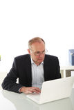 Middle-aged businessman with laptop Stock Photo
