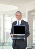 Middle aged Businessman with Laptop Computer Stock Photography