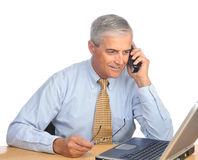 Middle Aged Businessman with laptop and phone Stock Photos