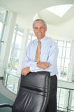 Middle aged Businessman Leaning on His Chair Stock Photography