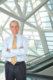 Middle Aged Businessman in Lobby Arms Folded Royalty Free Stock Photos