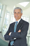 Middle Aged Businessman in Lobby Arms Folded Royalty Free Stock Photo