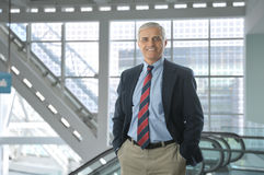 Middle aged Businessman in Lobby Modern Building Stock Image