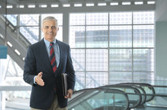 Middle aged Businessman in Lobby Modern Building Royalty Free Stock Photos