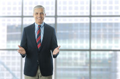 Middle aged Businessman in Lobby Modern Building Stock Images