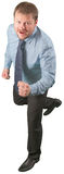 Middle-aged businessman moving on white background Royalty Free Stock Image