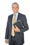 Middle aged Businessman with Notebook Stock Image