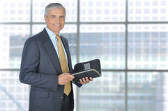 Middle aged Businessman with Planner Notebook Stock Photography