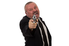 Middle aged businessman pointing gun Stock Image
