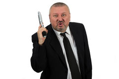Middle aged businessman pointing gun Royalty Free Stock Images