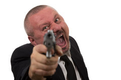 Middle aged businessman pointing gun Royalty Free Stock Image