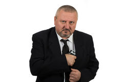 Middle aged businessman pointing gun Royalty Free Stock Photography