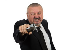 Middle aged businessman pointing gun Stock Photos