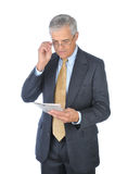Middle aged Businessman Reading Newspaper Stock Photos