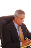 Middle Aged Businessman Seated Royalty Free Stock Photos
