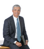 Middle Aged Businessman seated on his desk royalty free stock photo
