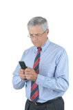 Middle aged Businessman Sending Text Message Royalty Free Stock Photography