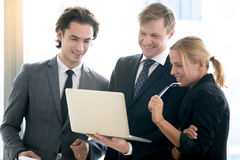Middle aged businessman showing progress to his team stock photo