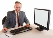 Middle Aged Businessman Sitting at his Desk Royalty Free Stock Images