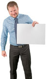 Middle-aged businessman standing with blank list of paper on white background Stock Photography