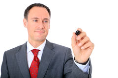 Middle-aged businessman starts to draw Stock Photos