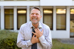 Middle-aged businessman suffering chest pains Royalty Free Stock Photography