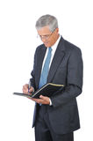 Middle Aged Businessman Taking Notes Royalty Free Stock Photo
