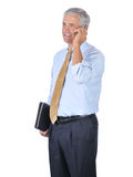 Middle aged Businessman Talking on Cell Phone Stock Images