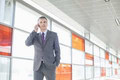 Middle aged businessman using cell phone at train station Royalty Free Stock Photo