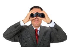 Middle-aged businessman using spyglass Stock Images