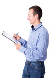 Middle aged businessman writing something in clipboard isolated Royalty Free Stock Photo