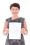 Middle aged businesswoman with blank clipboard Stock Photo
