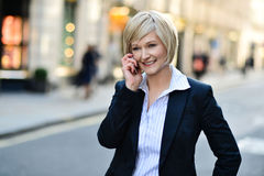 Middle aged businesswoman on cellphone Royalty Free Stock Photo