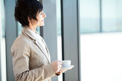 Middle aged businesswoman having coffee Royalty Free Stock Images