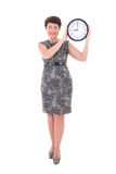 Middle aged businesswoman holding clock Stock Images