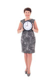 Middle aged businesswoman holding clock Royalty Free Stock Images
