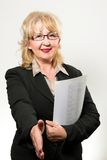 Middle aged businesswoman, holding documents Royalty Free Stock Images
