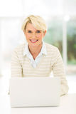 Middle aged businesswoman laptop Royalty Free Stock Photography