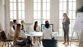 Free Middle-aged Businesswoman Lead Meeting Presenting Project On Whiteboard Stock Images - 214577374