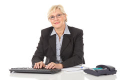 Middle aged businesswoman at office Royalty Free Stock Photography
