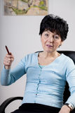 Middle-aged businesswoman at the office Royalty Free Stock Images