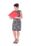 Middle aged businesswoman with open folder Stock Image