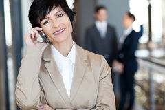 Middle aged businesswoman on phone Royalty Free Stock Photo
