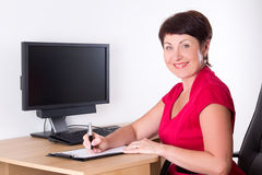 Middle aged businesswoman sitting in office Stock Photography