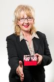 Middle aged businesswoman, smiling with present in hands Stock Photography