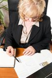 Middle aged businesswoman, writing document Royalty Free Stock Photo