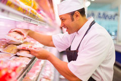 Middle aged butcher working Royalty Free Stock Photo