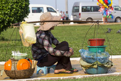 Middle aged Cambodian woman selling food near Angkor Wat Royalty Free Stock Image