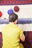 Middle-aged carpet weaver Royalty Free Stock Images