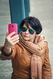 Middle aged caucasian brunette woman outside autumn in sunglasse Stock Images